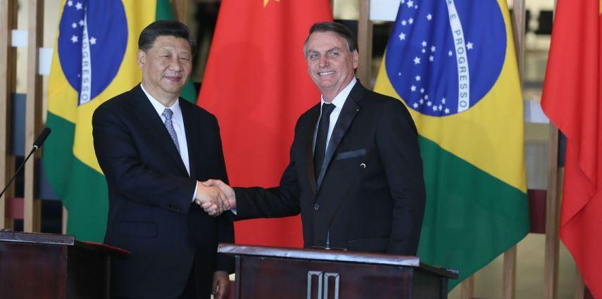 O presidente da China, Xi Jinping, e o presidente do Brasil, Jair Bolsonaro, durante evento dos BRICS, em Brasília, em novembro de 2019.